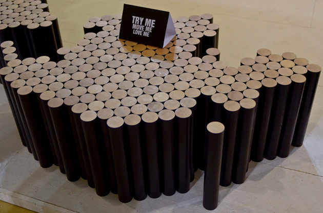 Raphael Charles' concept for a flexible coffee table composed of wooded cylinders